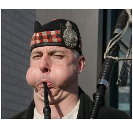 Extreme-bagpipe-player-with-puffed-cheeks[1]