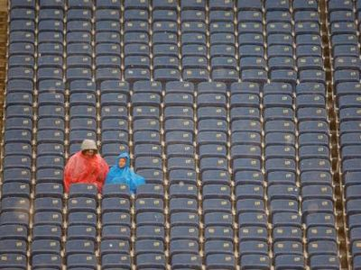 Football-empty-stadium-seats-rain[1]